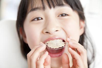 ポイント3.上の前歯の位置を整えること